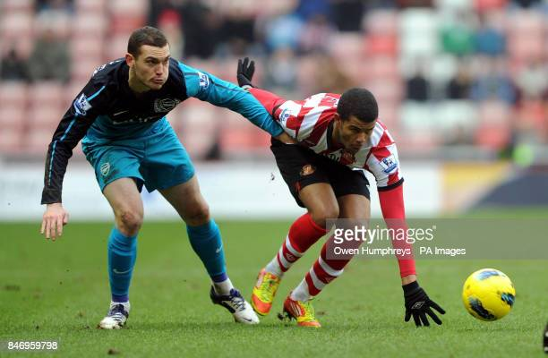 Arsenal's Thomas Vermaelen and Sunderland's Fraizer Campbell in action during the Barclays Premier League match at the Stadium of Light Sunderland