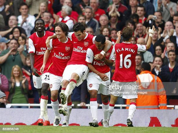 Arsenal's Tomas Rosicky celebrates with team mate Francesc Fabregas and Theo Walcott after scoring the second goal
