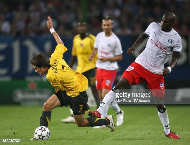 Arsenal's Tomas Rosicky Holds off challenge from Hamburg's Guy Demel during the UEFA Champions League Group G match at the AOL Arena Hamburg