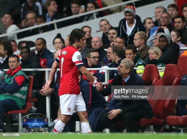 Arsenal's Tomas Rosicky shakes the hand of manager Arsene Wenger as he is substituted off the pitch