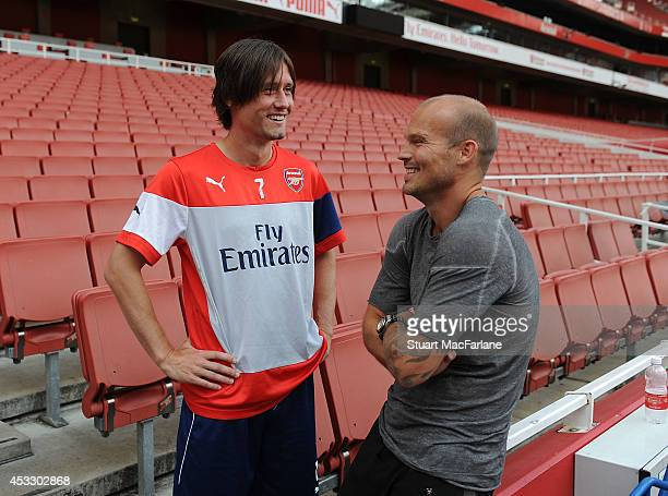 Arsenal's Tomas Rosicky with ex player Freddie Ljungberg after Members Day at Emirates Stadium on August 7 2014 in London England