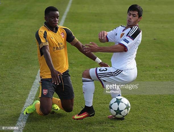 Arsenal's U19s Stephy Mavididi holds of FC Basle U19s Blas Miguel Riveros Galeano during UEFA Youth League match between Arsenal Under 19s and FC...