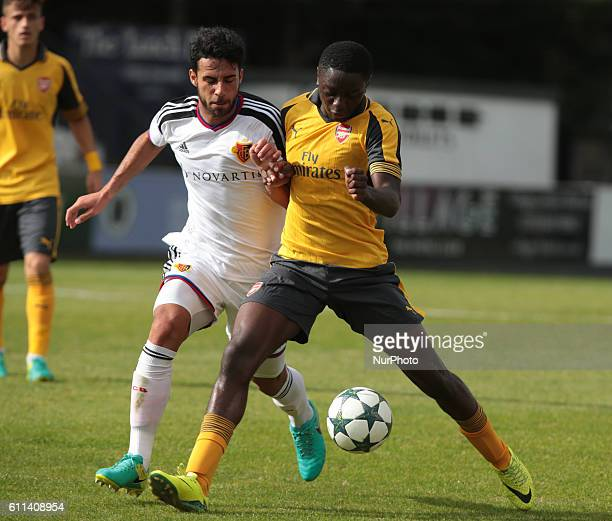 Arsenal's U19s Stephy Mavididi holds of FC Basle U19s Eray Cumart during UEFA Youth League match between Arsenal Under 19s and FC Basel Under 19s at...
