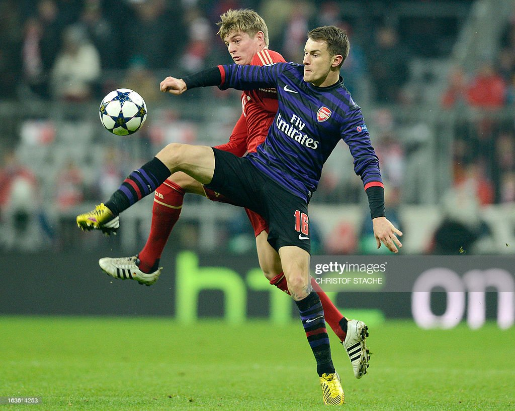 Arsenal´s Welsh midfielder Aaron Ramsey (R) and Bayern Munich's midfielder Toni Kroos vie for the ball during the UEFA Champions League Round of 16 second-leg football match FC Bayern Munich vs FC Arsenal London at the Allianz arena in Munich, southern Germany, on March 13, 2013. AFP PHOTO / CHRISTOF STACHE