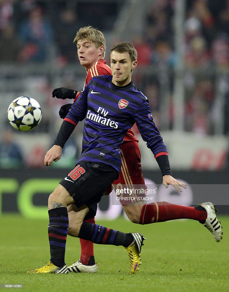 Arsenal´s Welsh midfielder Aaron Ramsey (R) and Bayern Munich's midfielder Toni Kroos vie for the ball during the UEFA Champions League Round of 16 second-leg football match FC Bayern Munich vs FC Arsenal London at the Allianz arena in Munich, southern Germany, on March 13, 2013.