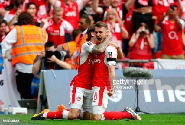 Arsenal's Welsh midfielder Aaron Ramsey celebrates with Arsenal's Spanish defender Hector Bellerin after scoring their second goal during the English...
