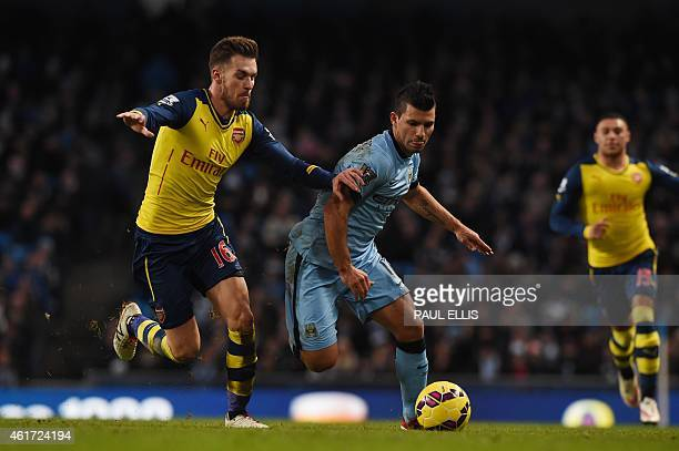 Arsenal's Welsh midfielder Aaron Ramsey chases Manchester City's Argentinian striker Sergio Aguero during the English Premier League football match...