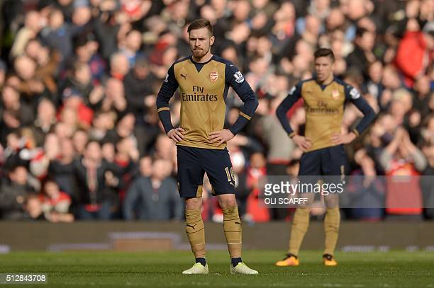 Arsenal's Welsh midfielder Aaron Ramsey reacts after Manchester United scored during the English Premier League football match between Manchester...