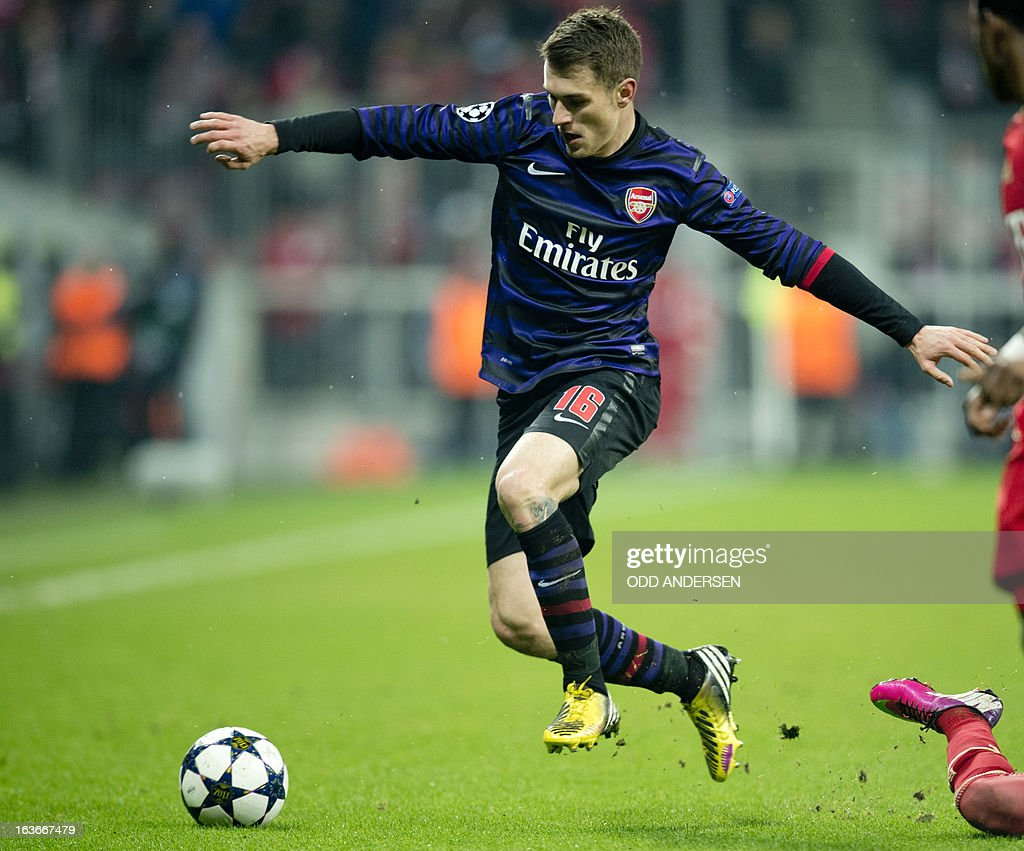 Arsenal's Welsh midfielder Aaron Ramsey runs with the ball during the UEFA Champions league round of 16 second leg football match Bayern Munich vs Arsenal at the Allianz arena in Munich, southern Germany on March 13, 2013. Bayern Munich advanced to the quarter finals on a 3-2 aggregate win losing 0-2 to Arsenal on the night.