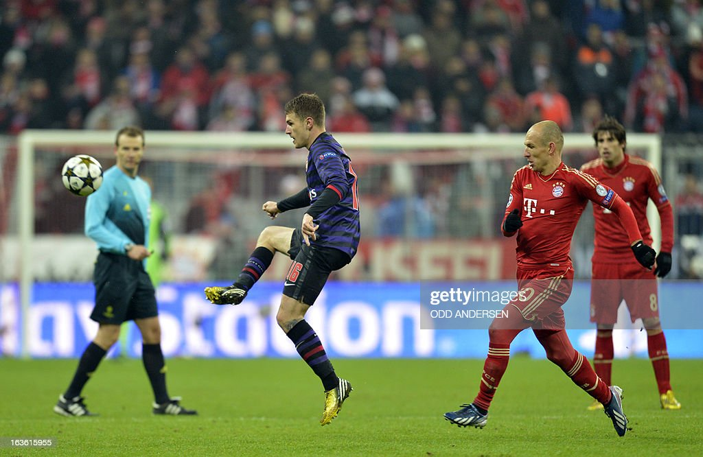 Arsenal´s Welsh midfielder Aaron Ramsey (L) vies for the ball with Arjen Robben (2nd R) and Javier Martinez (R) during the UEFA Champions League Round of 16 second-leg football match FC Bayern Munich vs FC Arsenal London in Munich, southern Germany, on March 13, 2013.