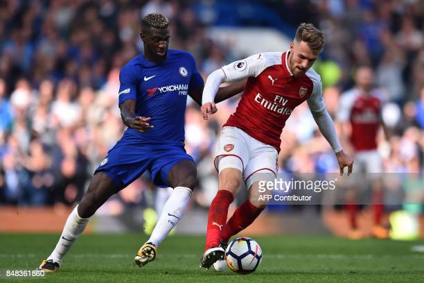 Arsenal's Welsh midfielder Aaron Ramsey vies with Chelsea's French midfielder Tiemoue Bakayoko during the English Premier League football match...