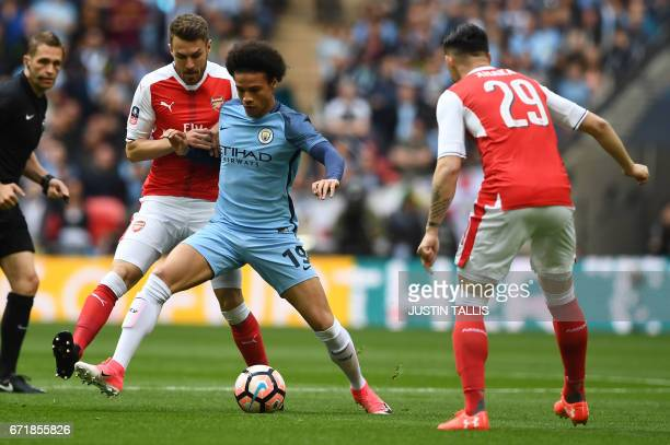 Arsenal's Welsh midfielder Aaron Ramsey vies with Manchester City's German midfielder Leroy Sane during the FA Cup semifinal football match between...