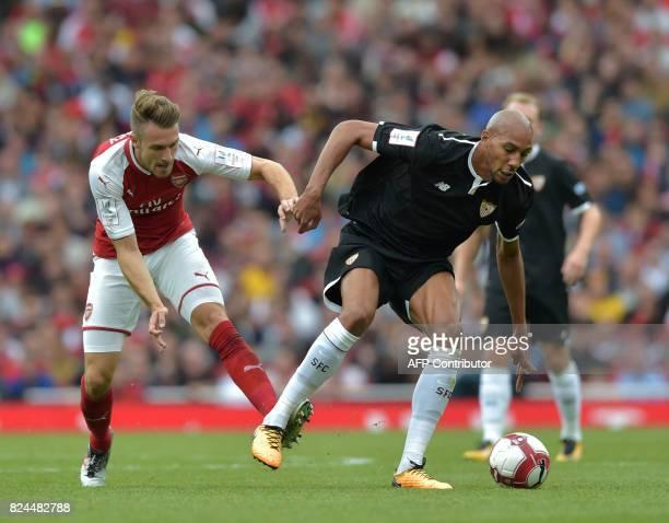 Arsenal's Welsh midfielder Aaron Ramsey vies with Sevilla's Steven N'Zonzi during the preseason friendly football match between Arsenal and Sevilla...