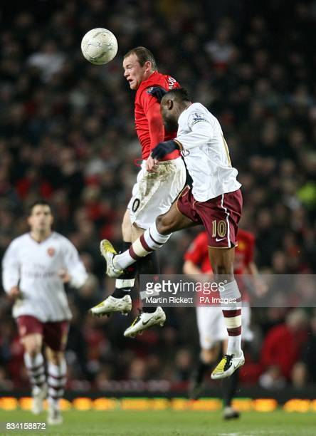 Arsenal's William Gallas and Manchester United's Wayne Rooney battle for the ball in the air