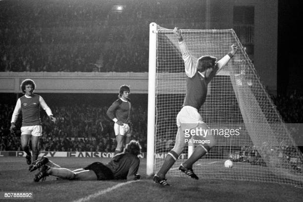 Arsenal's Willie Young celebrates scoring past FC Magdeburg goalkeeper Dirk Heyne