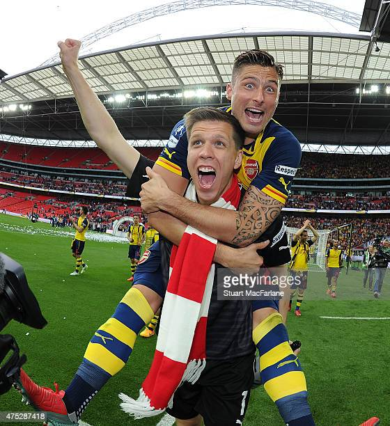 Arsenal's Wojciech Szczesny and Olivier Giroud celebrate after the FA Cup Final between Aston Villa and Arsenal at Wembley Stadium on May 30 2015 in...