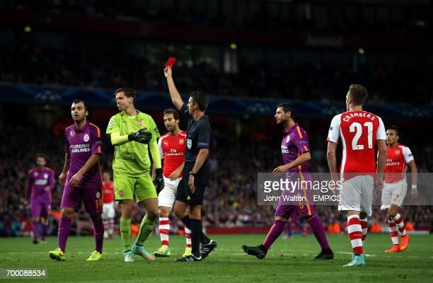 Arsenal's Wojciech Szczesny is shown a red card by referee Gianluca Rocchi