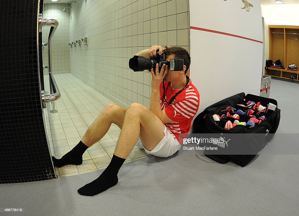 Arsenal's Wojciech Szczesny photographs the team arriving before the Barclays Premier League match between Arsenal and Liverpool at Emirates Stadium on April 4, 2015 in London, England. Photo by Stuart MacFarlane/Arsenal FC via Getty Images)