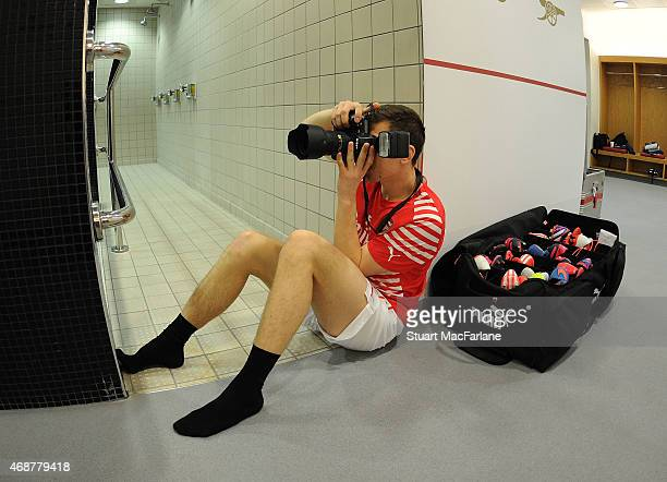 Arsenal's Wojciech Szczesny photographs the team arriving before the Barclays Premier League match between Arsenal and Liverpool at Emirates Stadium...