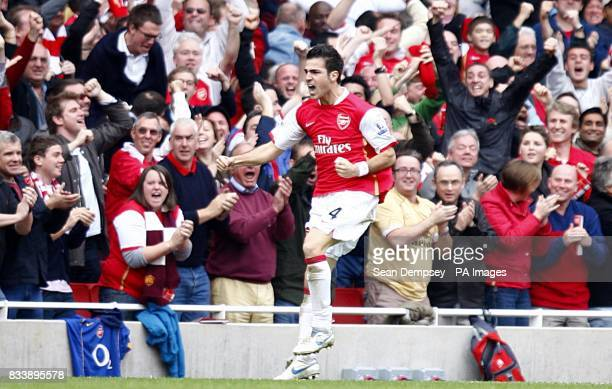 Arsenals's Francesc Fabregas celebrates scoring an equalising goal in the second half