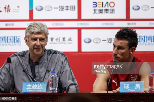 Arsene Wenger and Laurent Koscielny of Arsenal reacts during prematch press conference at Birds Nest on July 21 2017 in Beijing China