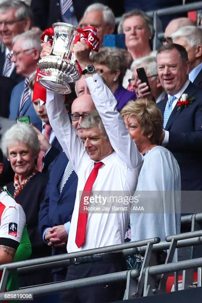 Arsene Wenger head coach / manager of Arsenal lifts the Emirates FA Cup during the Emirates FA Cup Final match between Arsenal and Chelsea at Wembley...