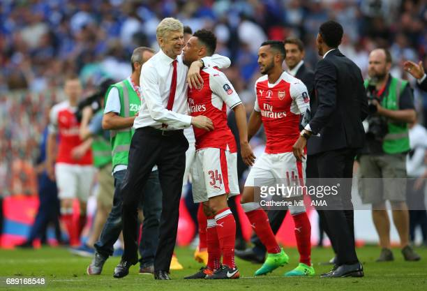 Arsene Wenger manager / head coach of Arsenal celebrates with Francis Coquelin of Arsenal during the Emirates FA Cup Final match between Arsenal and...