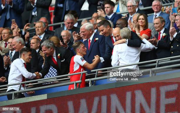 Arsene Wenger manager / head coach of Arsenal is hugged by Ivan Gazidis chief executive of Arsenal after the Emirates FA Cup Final match between...