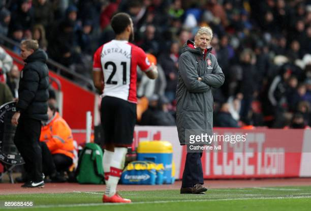 Arsene Wenger manager / head coach of Arsenal looks over to Ryan Bertrand of Southampton during the Premier League match between Southampton and...