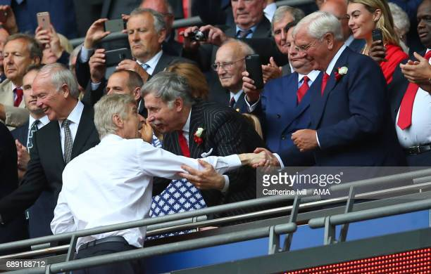 Arsene Wenger manager / head coach of Arsenal shakes hands with Chips Keswick chairman of Arsenal during the Emirates FA Cup Final match between...