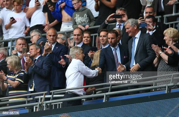 Arsene Wenger manager / head coach of Arsenal shakes hands with England manager Gareth Southgate and David Gill during the Emirates FA Cup Final...