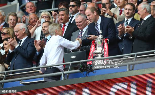 Arsene Wenger manager / head coach of Arsenal shakes hands with the Prince William the Duke of Cambridge during the Emirates FA Cup Final match...