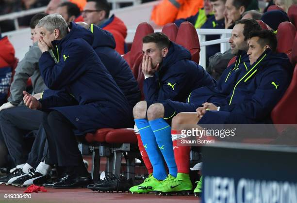 Arsene Wenger Manager of Arsenal Aaron Ramsey Petr Cech and Alexis Sanchez of Arsenal look dejected on the bench during the UEFA Champions League...