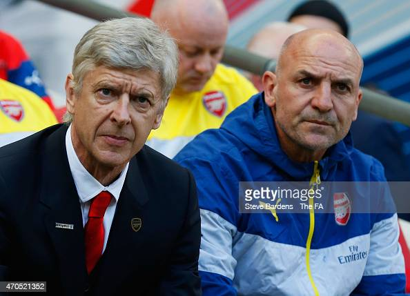Arsene Wenger manager of Arsenal and asisstant Steve Bould look on from the bench prior to the FA Cup SemiFinal match between Arsenal and Reading at...