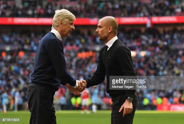 Arsene Wenger manager of Arsenal and Josep Guardiola manager of Manchester City shake hands after the Emirates FA Cup SemiFinal match between Arsenal...