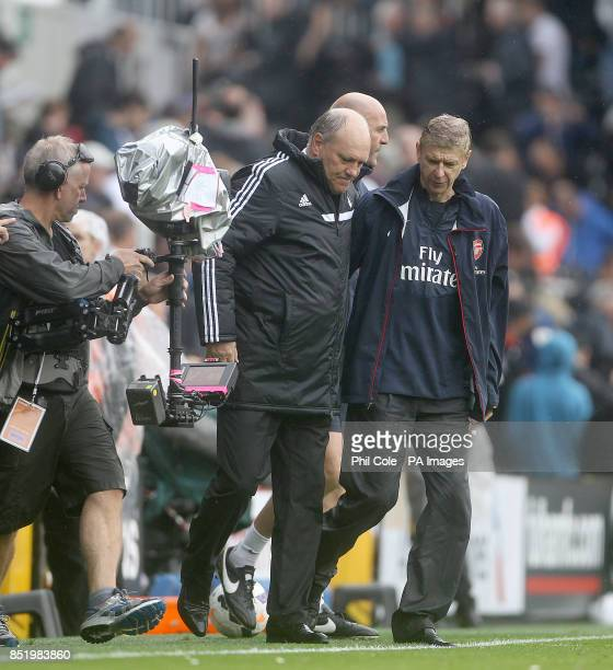 Arsene Wenger manager of Arsenal and Martin Jol Manager of Fulham during the Barclays Premier League match at Craven Cottage London