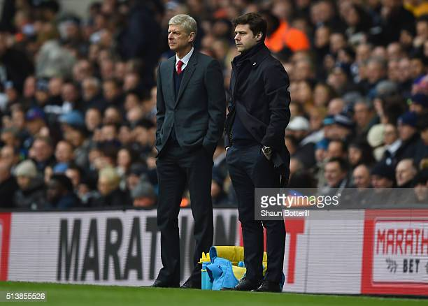 Arsene Wenger manager of Arsenal and Mauricio Pochettino manager of Tottenham Hotspur look on from the touchline during the Barclays Premier League...
