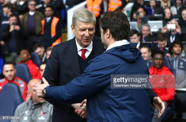 Arsene Wenger Manager of Arsenal and Mauricio Pochettino Manager of Tottenham Hotspur shake hands prior to the Premier League match between Tottenham...