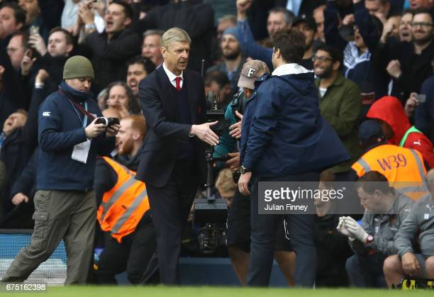 Arsene Wenger Manager of Arsenal and Mauricio Pochettino Manager of Tottenham Hotspur shake hands after the Premier League match between Tottenham...
