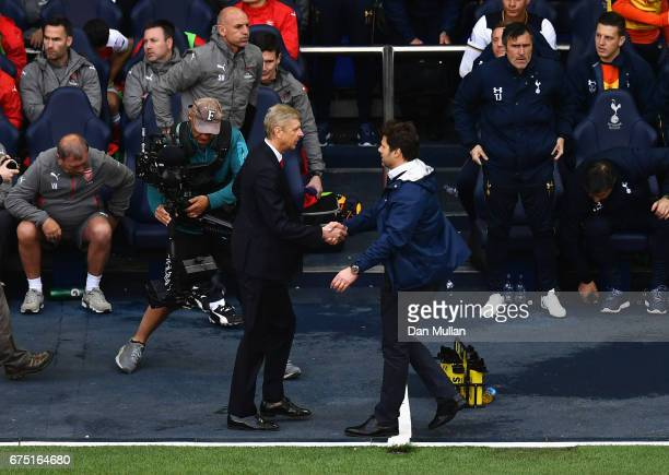 Arsene Wenger Manager of Arsenal and Mauricio Pochettino Manager of Tottenham Htspur embrace after during the Premier League match between Tottenham...