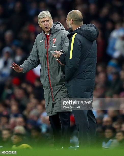 Arsene Wenger Manager of Arsenal argues with Josep Guardiola Manager of Manchester City during the Premier League match between Manchester City and...