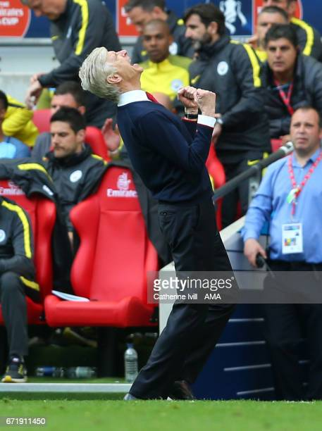Arsene Wenger manager of Arsenal celebrates at the end of the Emirates FA Cup semifinal match between Arsenal and Manchester City at Wembley Stadium...