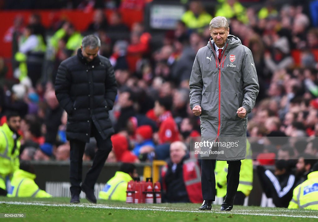 Arsene Wenger, Manager of Arsenal (R) celebrates during the Premier League match between Manchester United and Arsenal at Old Trafford on November 19, 2016 in Manchester, England.