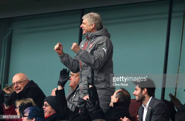 Arsene Wenger Manager of Arsenal celebrates his team's first goal in the stand during the Premier League match between Arsenal and Hull City at...
