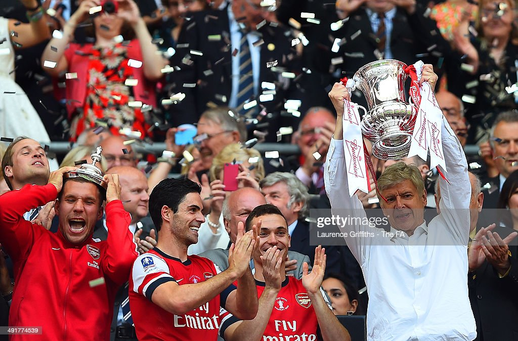 Arsene Wenger manager of Arsenal celebrates with his players as he lifts the FA Cup after the FA Cup with Budweiser Final match between Arsenal and...
