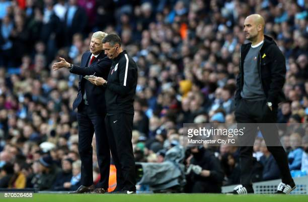 Arsene Wenger Manager of Arsenal complains to the fourth offical Andre Marriner during the Premier League match between Manchester City and Arsenal...