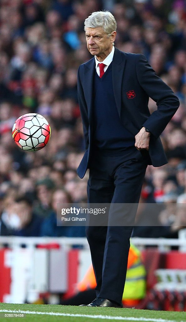 <a gi-track='captionPersonalityLinkClicked' href=/galleries/search?phrase=Arsene+Wenger&family=editorial&specificpeople=171184 ng-click='$event.stopPropagation()'>Arsene Wenger</a>, manager of Arsenal controls the ball during the Barclays Premier League match between Arsenal and Norwich City at The Emirates Stadium on April 30, 2016 in London, England