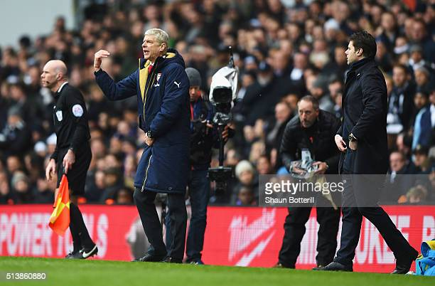Arsene Wenger Manager of Arsenal gestures while Mauricio Pochettino Manager of Tottenham Hotspur looks on during the Barclays Premier League match...