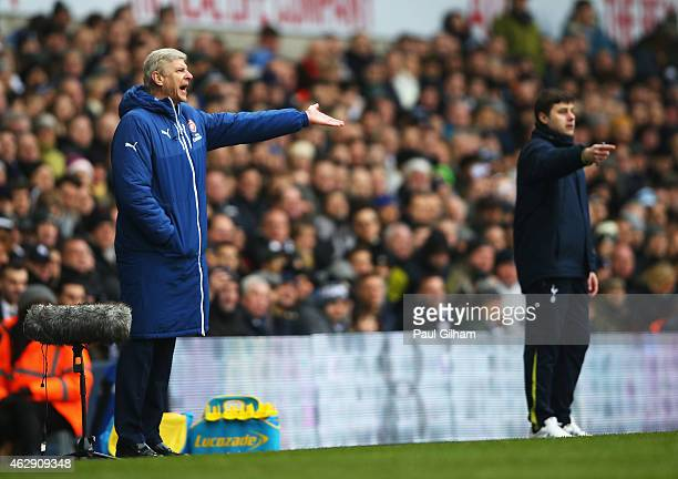 Arsene Wenger manager of Arsenal gestures with Mauricio Pochettino manager of Tottenham Hotspur during the Barclays Premier League match between...