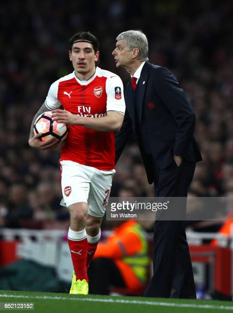 Arsene Wenger Manager of Arsenal gives instructions as Hector Bellerin of Arsenal takes a throw in during The Emirates FA Cup QuarterFinal match...